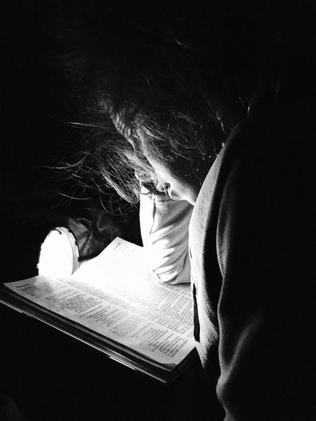 Daughter woke up at 5am and asks to read her Bible. Snapshots Of Life Kids Kids Being Kids Joy Light And Shadow Reading Portraits The Moment - 2015 EyeEm Awards Learn & Shoot: Single Light Source B&W Portrait