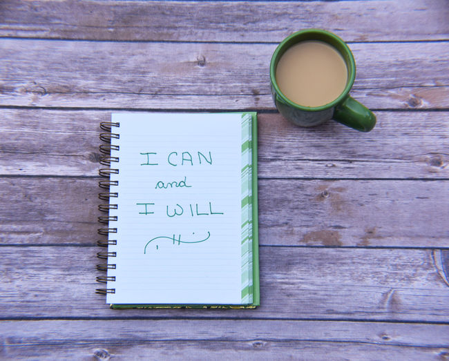 Flooring I Can And I Will Close-up Coffee - Drink Coffee Cup Day Diary Drink Food And Drink Freshness High Angle View Indoors  Motivational Quotes No People Notebook Refreshment Table Text To Do List Wood - Material