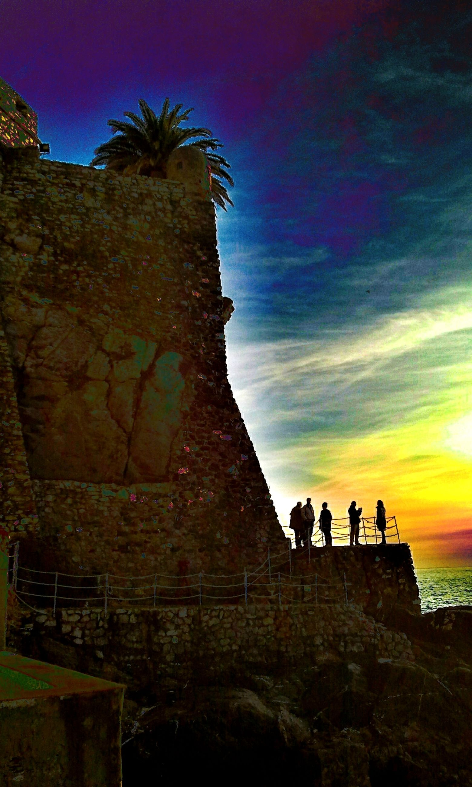 silhouette, sky, sunset, lifestyles, men, leisure activity, rock - object, rock formation, person, tranquility, nature, beauty in nature, tranquil scene, tree, tourist, low angle view, scenics, tourism