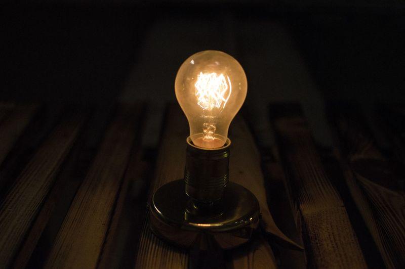 Close-up of lit light bulb