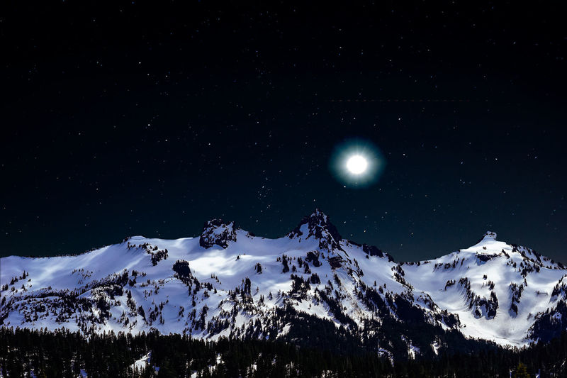Moon rise over snow capped mountains on a starry night Astronomy Beauty In Nature Clear Sky Cold Temperature Full Moon Illuminated Landscape Majestic Moon Moon Surface Moonlight Mountain Mountain Range Nature Night No People Outdoors Scenics Sky Snow Snowcapped Mountain Star - Space Tranquil Scene Tranquility Winter