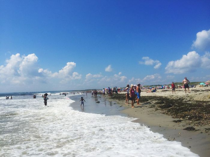 Large Group Of People Beach Sea Water Sky