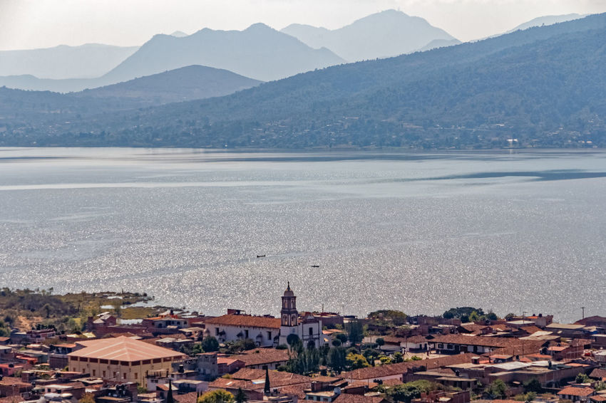 The view over Lake Patzcuaro in Michoacan state, Mexico Architecture Blue City Cityscape Day Horizontal Lake Patzcuaro Mexico Michoacan, México Mountain Mountains Nature No People Outdoors Scenic Sea Sky Sunset Town Travel Destinations Urban Skyline View Water