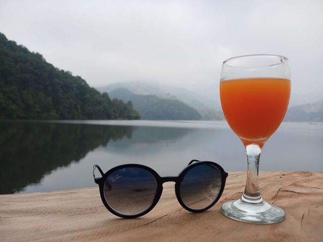 my breakfast place view in pokhara ! city of mountains #scenic #shades #sunglasses #beach #water #wine #wineglass #breakfast #tree #water #cityofmountain #pokhara #RayBan Tranquility Calm Countryside Non-urban Scene Tranquil Scene Foggy First Eyeem Photo