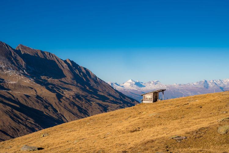 Alpenhütte im Valser Tal Swissalps Swiss Alps Swiss Hut Alpenütte Panorama Mountain Mountains EyeEm Selects Mountain Blue Sky Architecture Landscape Mountain Range Building Exterior