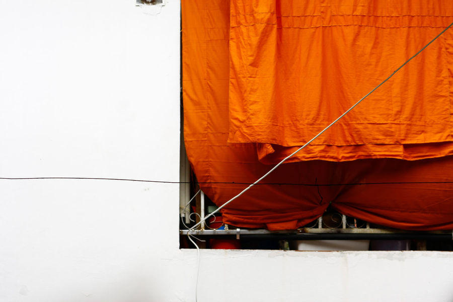 Dry Clothes In The Air Clothes Fine Art Photography Clothesline Clothing Dry EyeEm Best Shots EyeEm Gallery Fabric Nature No People Orange Orange Color Outdoors Quadrilateral Square Textile Wall Wall - Building Feature White White Color White Wall Yellow Robe