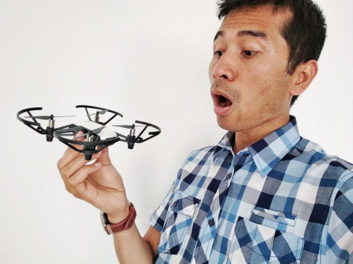 Man Holding Drone Against White Background