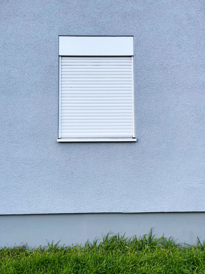 Window on white wall of building