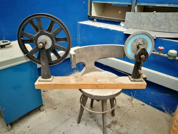 Metallic structure by sea against blue sky