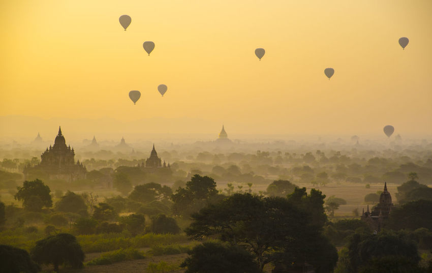 A magical sunrise over stupas in beautiful landscapes of Old Bagan. (Bagan, Myanmar 2016) Ancient Architecture Bagan, Myanmar Beautiful Beauty In Nature Burma Architecture Documentary Flying Hot Air Balloon Landscape Mid-air Myanmar View Nature Orange Color Outdoors Romantic Sky Sky Spire  Sun Sunset Tranquil Scene Tranquility Tree Wide Shot Yellow
