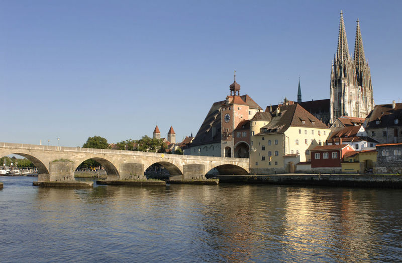 medieval city Regensburg with landmark old stone bridge over river Danube Bavaria Cathedral City Cityscape Danube Regensburg Sightseeing Travel Architecture Bridge - Man Made Structure Building Exterior Built Structure City Clear Sky Landmark Medieval No People Old Stone Bridge Religion River Sky Spirituality Stone Bridge Travel Destinations Waterfront