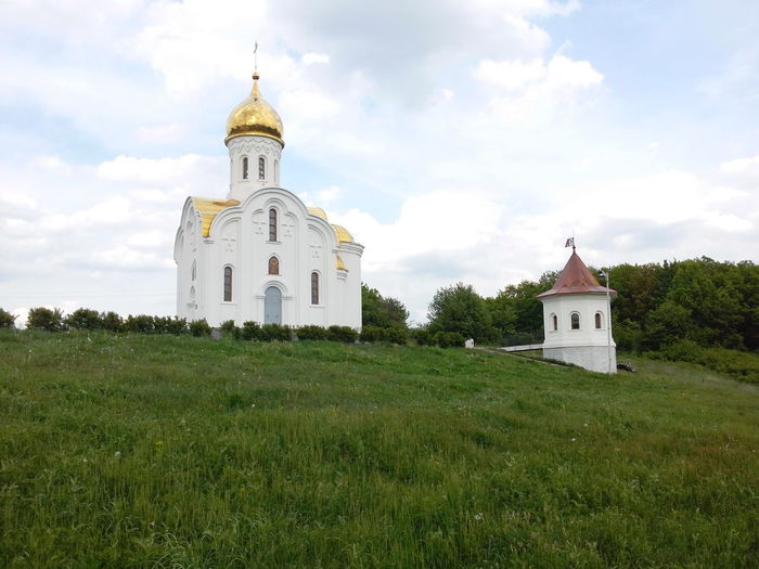 Small chapel standing on a grassy hill