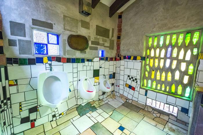Kawakawa (New Zealand) Public Toilets project by Austrian artist Hundertwasser. Art Artist ArtWork Austrian Artist Colorful Day Geometric Shape Hundertwasser Kawakawa Multi Colored Neuseeland New Zealand No People Public Toilet Toilet