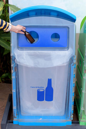Bin or Trash with girl's hands are dropping the bottles in recyclable garbage. Blue Container Day Environmental Conservation Finger Front View Garbage Bin Hand Holding Human Body Part Human Hand Lifestyles Men One Person Outdoors Real People Recycling Recycling Bin Standing Sustainable Lifestyle Unrecognizable Person