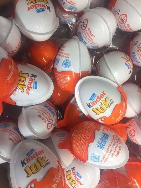 Berlin, Germany - February 10, 2018: Kinder Joy or Kinder Merendero, candy made by Italian confectionery company Ferrero as part of its Kinder brand of products Kinder Kinder Joy  Snack Choice Close-up Confectionery Directly Above Ferrero Food Kinder Ferrero Large Group Of Objects Merendero Multi Colored No People Sweet Sweet Food