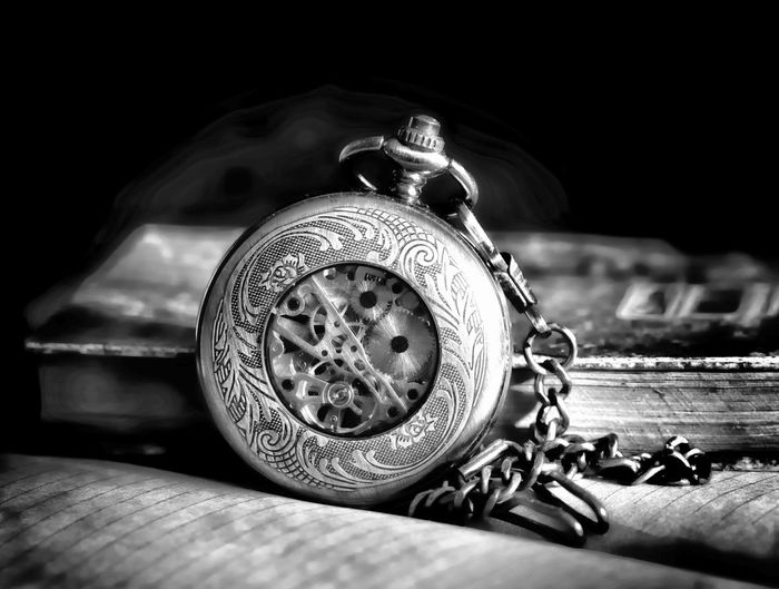 Indoors  Metal Close-up Still Life Watch Table Antique No People Clock Time Retro Styled Pocket Watch Selective Focus Technology Chain Wood - Material Number Transportation Studio Shot Black Background Small Personal Accessory