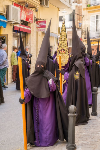 People in the procession in the Holy Week (Semana Santa) in a Spanish city. Malaga, Spain - March 26, 2018. Catolic Church Children Easter Easter Ready Historical Building Holy Week Malaga People Watching SPAIN Semana Santa Spanish Uniform Uniforms Architecture Belief Building Building Exterior Built Structure Catolicism City Clothing Day España Festival Group Of People Lifestyles Men Musical Instrument Musician Musician Bands Old Buildings Outdoors People Procession Real People Religion Sabor Spain Is Different Spanish Arquitecture Spanish Culture Street Traditional Clothing Women The Street Photographer - 2018 EyeEm Awards The Traveler - 2018 EyeEm Awards
