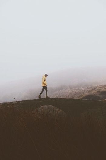 Full length of man walking on land against sky