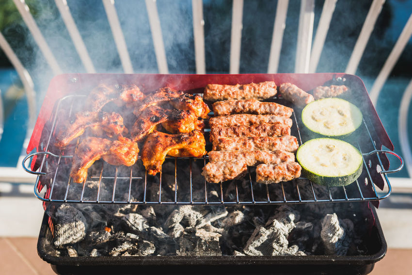 Delicious meat on barbecue grill with coal on balcony. Grilling food on a balcony or a terrace with wonderful view. Small cheap BBQ grill at home. BBQ BBQ Time Cooking Meal Terrace View Apartment Balcony Barbecue Barbecue Grill Block Cevapi Charcoal Coal Delicious Fire Food Fresh Grill House Juicy Meat Outdoors Picnik Preparing