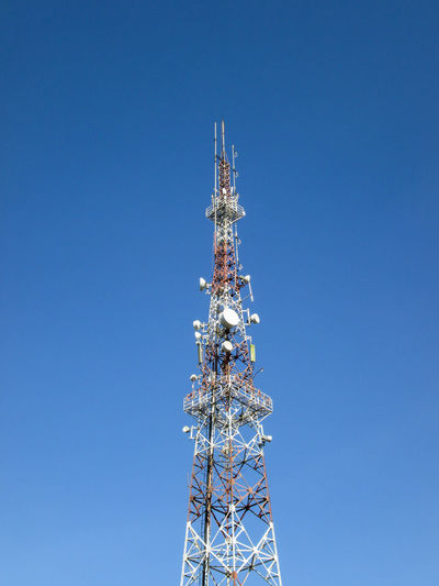 Telecommunication signal radio tower metal construction with clear blue skies background