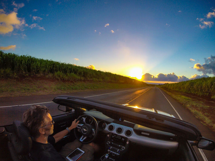 Driving into the sunset is done best in an awesome sports car. Adventure Car Miles Away Convertible Cruisin Driving Ford Ford Mustang Having Fun Hawaii Journey Mustang Oahu On The Road Open Top Outdoors Road Self Portrait Sports Car Sunset The Drive The Way Forward Travel USA Finding New Frontiers Let's Go. Together. Second Acts Second Acts