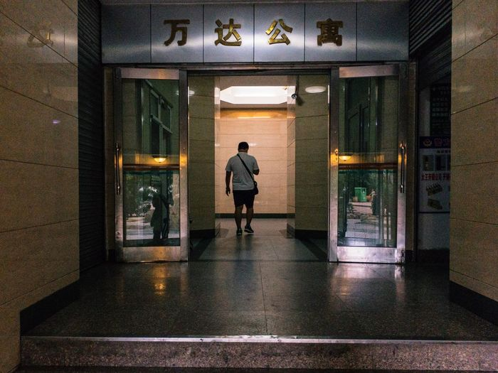 Dalian, Liaoning, China 2017 MelbournePhotographer IPhoneography Streetphotography Mobilephotography Adobelightroommobile Vscocam Rear View One Person Full Length Walking Indoors  Night Real People Politics And Government Architecture Lifestyles Men Illuminated Women Adult People Adults Only Only Men