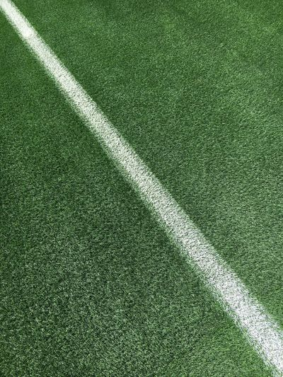 High angle view of white single line on soccer field