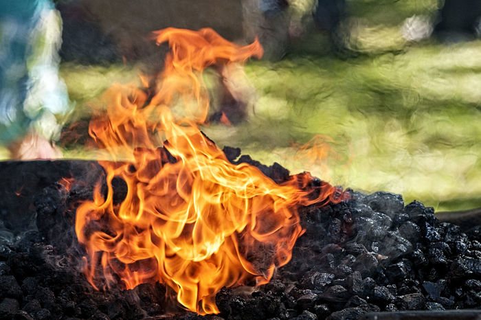 The burning coals heat the metal and allow the the blacksmith to shape it. Anvil Blacksmith  Burning Coals Chain Fire Forge  Hammer Hammer & Anvil Hands At Work Heatwave Hot Coals Smoke Working Gloves