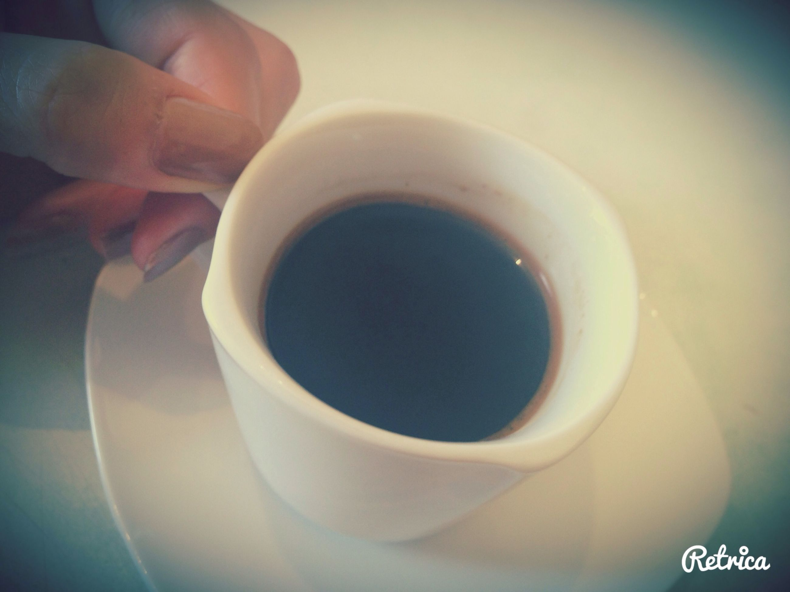 coffee cup, indoors, drink, refreshment, coffee - drink, cup, food and drink, coffee, close-up, saucer, freshness, person, part of, still life, high angle view, cropped, table