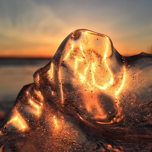 Armor of Light Cold And Warm Cold Weather Electrifying Michigan Winter Winter Ice Light Sunset Sunrise Light Ice Sunset Sky Water Beach Sea Nature Capture Tomorrow Close-up Orange Color Beauty In Nature Outdoors Scenics - Nature Tranquility No People Focus On Foreground Reflection Sunlight Idyllic