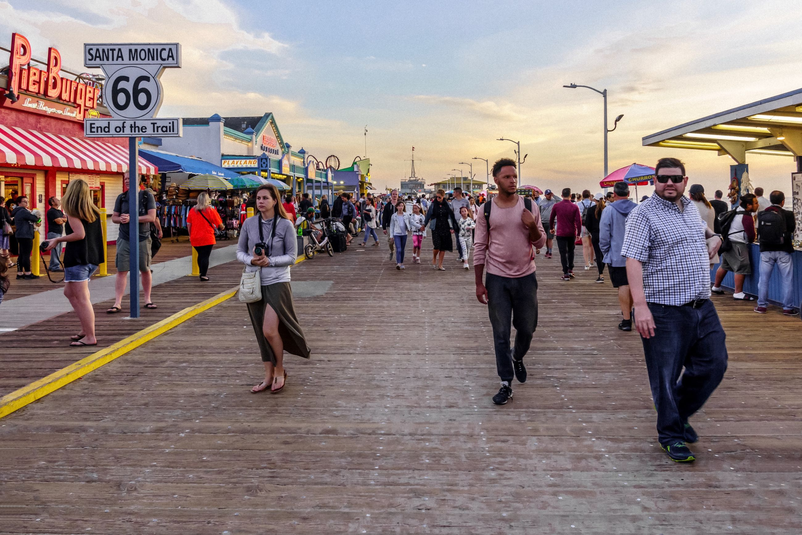 real people, group of people, crowd, large group of people, men, walking, architecture, women, city, built structure, lifestyles, building exterior, adult, sky, cloud - sky, street, leisure activity, outdoors, motion