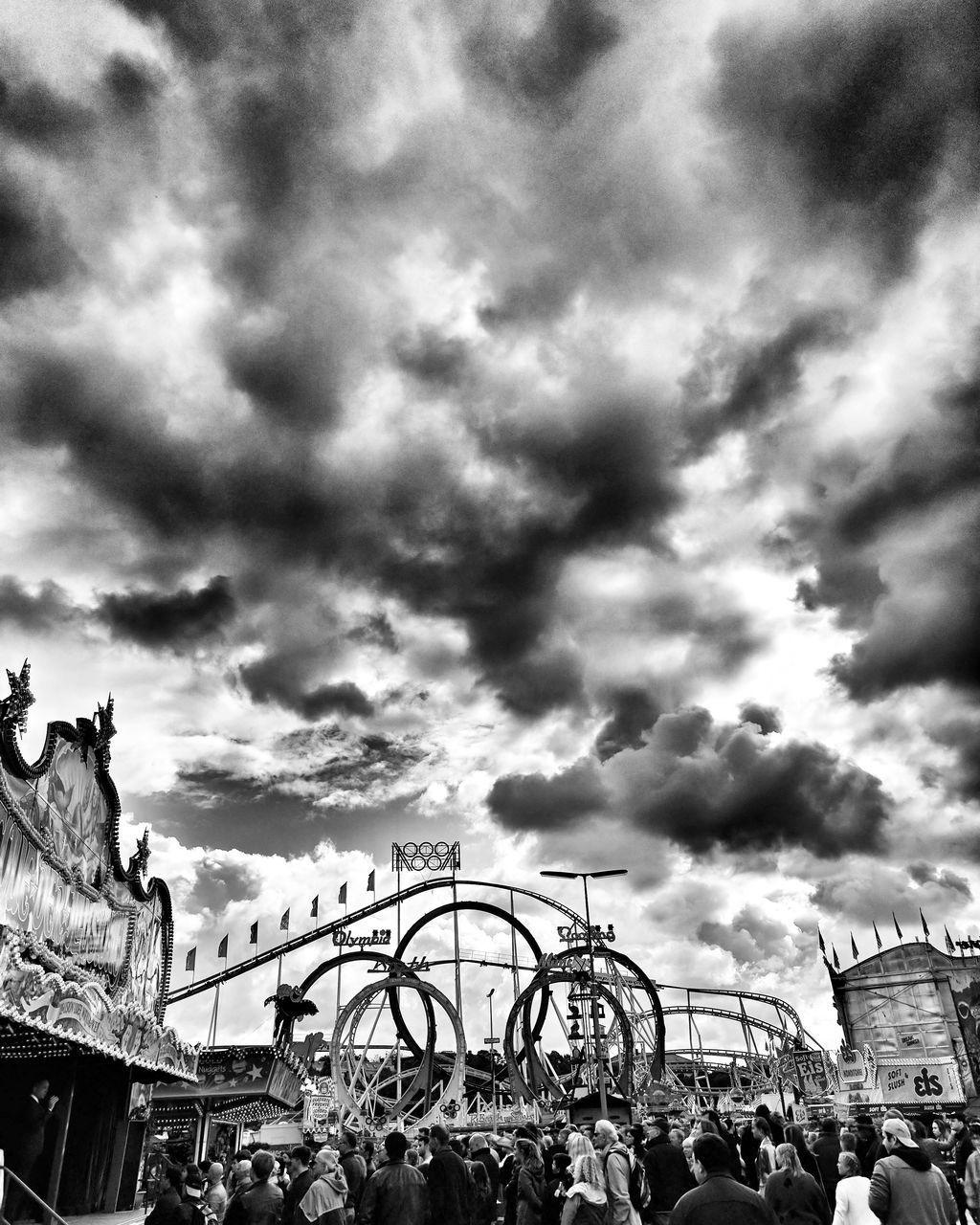 large group of people, amusement park, cloud - sky, sky, arts culture and entertainment, leisure activity, amusement park ride, real people, fun, outdoors, enjoyment, women, day, crowd, men, built structure, carousel, nature, people