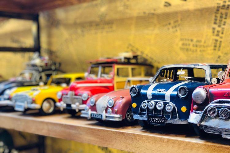 Toy cars in shelf