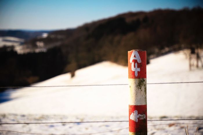 Bollard Stake Blue Sky Fence Red Red White Bergneustadt Symbol Warning Sign Warning Sign A4 Focus On Foreground No People Day Mountain Outdoors Red Winter Close-up Cold Temperature Snow Nature Sky Clear Sky