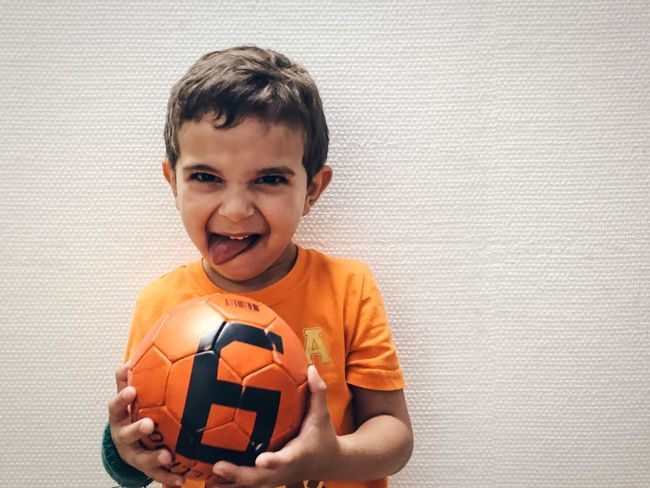 Face Face Expression Portrait Portrait Of A Friend Model Kids Fun Football Soccer Dutch Play Boy Young Men Peoplephotography People Watching People Together IPhoneography Having Fun Showcase July Children Enjoying Life Playing Orange Orange Color Oranje