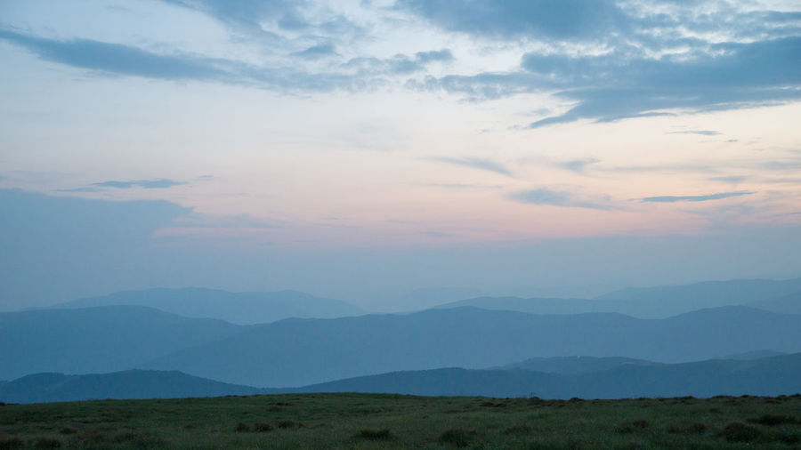 Background with mountains in the fog. Sunset time Cloud - Sky Scenics - Nature Beauty In Nature Sky Tranquil Scene Tranquility Mountain Environment Landscape No People Nature Non-urban Scene Mountain Range Idyllic Outdoors Remote Day Sunset Land