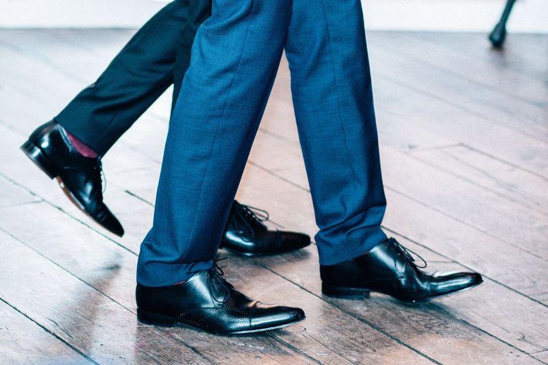 Low Section Of Businessmen Walking On Floorboard