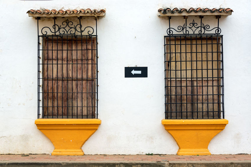 View of old colonial windows in the town of Mompox, Colombia American Architecture City Cityscape Colombia Downtown Façade Latin Magdalena Mompos Mompox  UNESCO World Heritage Site Building Colonial Heritage Historic Historical House Landmark Old Southamerica Street Town Unesco Urban