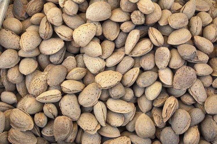 Full frame shot of roasted shelled almonds for sale