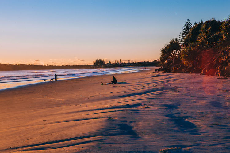 Australia Beach Beauty In Nature Clear Sky Coastline Incidental People Nature Non-urban Scene Outdoors Scenics Sea Shore Sky Sunset Surfer Tide Tourism Tourist Tranquil Scene Tranquility Travel Travel Destinations Vacations Water Wave The Traveler - 2018 EyeEm Awards
