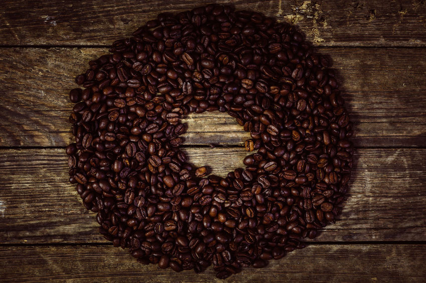 EyeEmNewHere Food And Drink Wood - Material Food Table Coffee Freshness Indoors  Still Life Brown Coffee - Drink Roasted Coffee Bean Directly Above No People Large Group Of Objects Close-up Wellbeing Abundance Healthy Eating High Angle View Love Caffeine