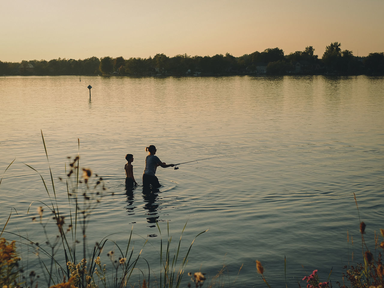 water, lake, sky, men, real people, beauty in nature, nature, fishing, reflection, two people, non-urban scene, tranquil scene, rod, people, lifestyles, tranquility, scenics - nature, sunset, fishing rod, outdoors