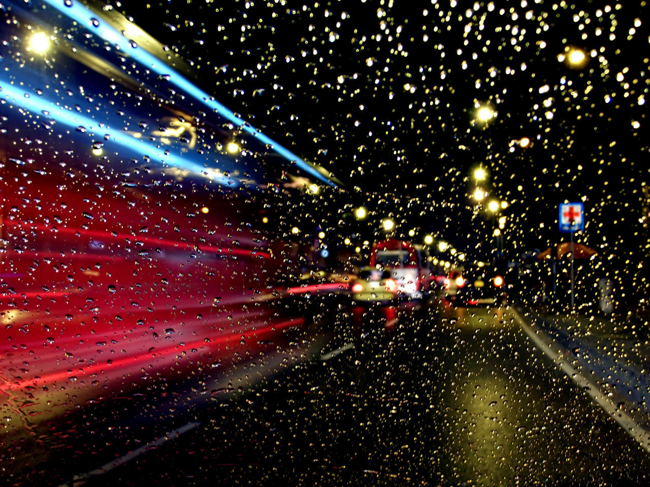 Water Drops On Windshield At Night