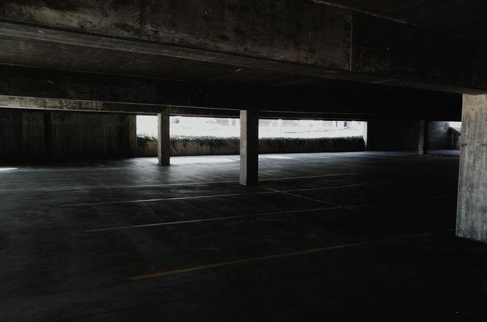Grunge garage Darkness Personal Perspective Parking Garage Lights And Shadows Perspective HighContrastPhotography Utahphotographer Darkness And Light Highcontrast Darktones Built Structure No People Day