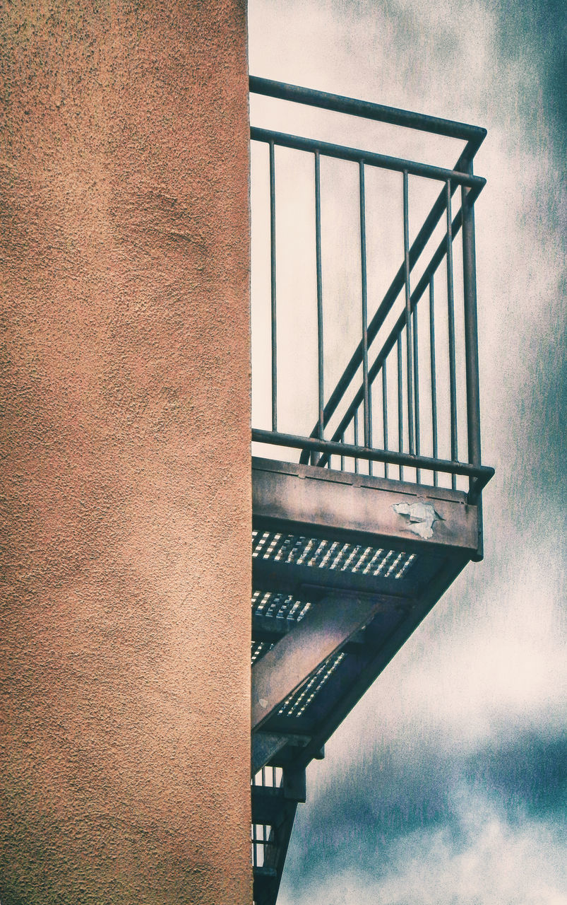 architecture, built structure, railing, bridge, no people, staircase, steps and staircases, sky, bridge - man made structure, connection, day, low angle view, metal, nature, building exterior, cloud - sky, spiral, spiral staircase, outdoors, building, alloy, steel