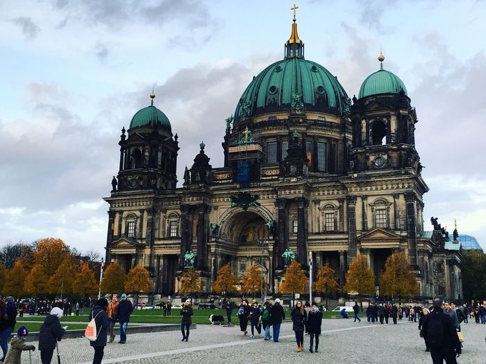People outside berlin cathedral against sky