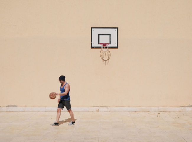 Ball Basketball - Sport Basketball Hoop Casual Clothing Childhood Day Elementary Age Full Length Leisure Activity Lifestyles Males  One Boy Only One Person Outdoors People Playing Real People Standing Young Adult Live For The Story The Street Photographer - 2017 EyeEm Awards