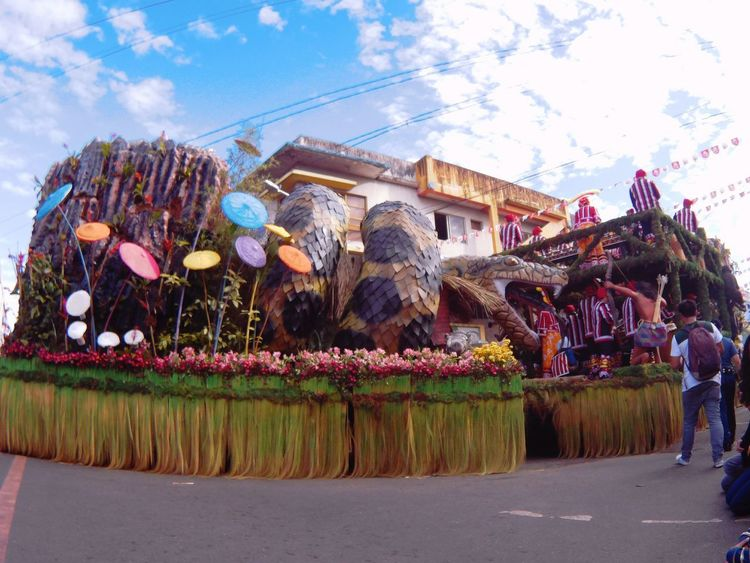 Float Parade - Kaamulan 2017 Sky Architecture Building Exterior Built Structure Cloud - Sky Flower Tree City Outdoors Large Group Of People Day Nature People Celebration Traditional Festival Travel Destinations Traditional Clothing Travelph Eyeem Philippines Choosephilippines Travelphotography SupremoWorld Photooftheday Itsmorefuninthephilippines Kaamulan2017