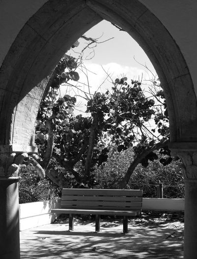 sometimes saying nothing is a good thing........ Bench EyeEm Nature Lover Have A Seat & Relax Arch Architecture Beauty In Nature Black And White Built Structure No People Quiet Place