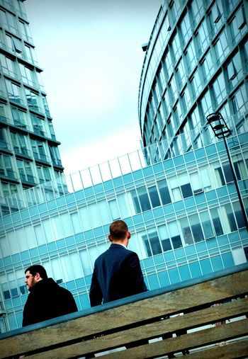 Low angle view of two people in office building